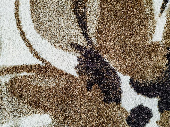 Full frame shot of cross on sand