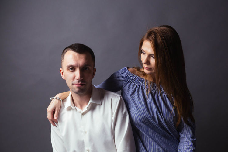Adult Black Background Couple - Relationship Gray Gray Background Hairstyle Heterosexual Couple Indoors  Love Men People Positive Emotion Studio Shot Togetherness Two People Waist Up Women Young Adult Young Couple Young Men Young Women