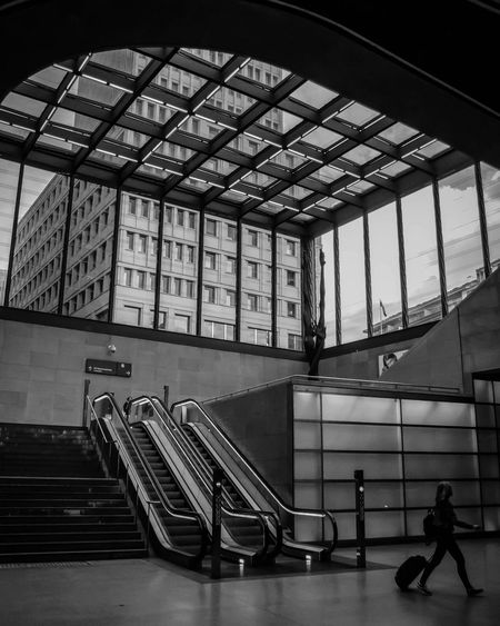 Indoors  Steps And Staircases Architecture Built Structure Window Staircase Railing Steps Railroad Station One Person Luggage EyeEm Awards 2017 Illuminated Black & White Bnw Monochrome Black And White Light And Shadow Blackandwhite Photography Station City Modern Architecture Travel Travel Destinations