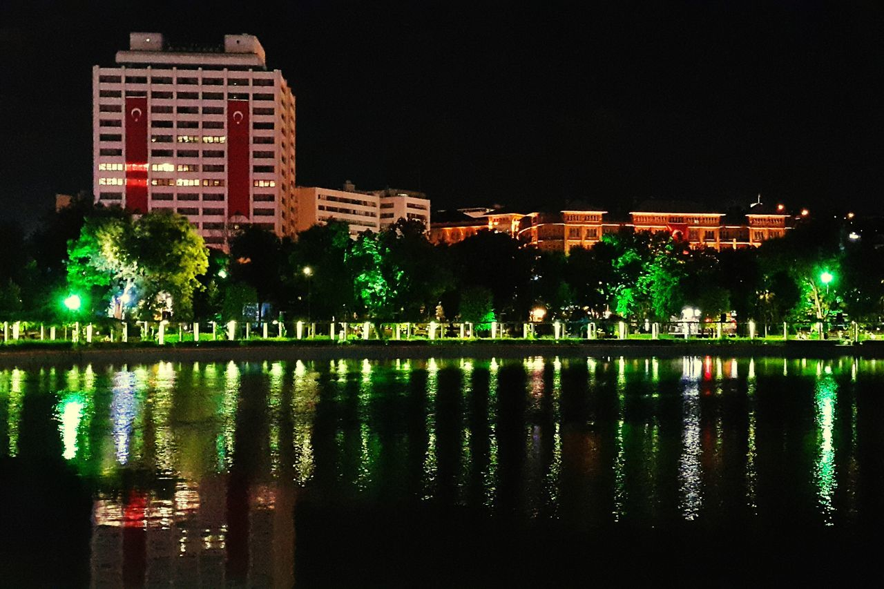 reflection, night, architecture, water, building exterior, built structure, illuminated, waterfront, no people, outdoors, sky, city, clear sky, tree