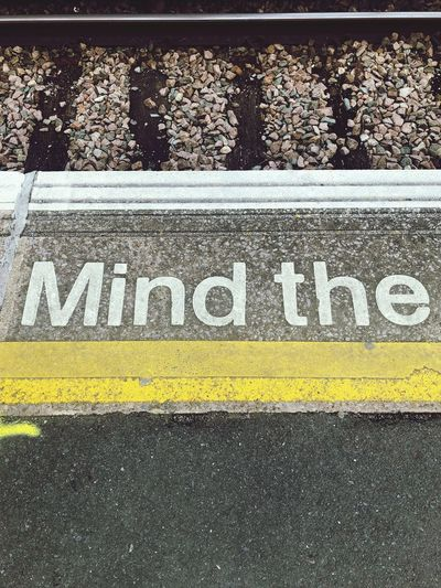 High angle view of text on railroad station platform