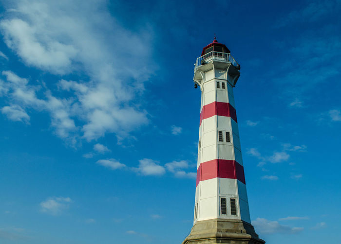 Low angle view of lighthouse against blue sky