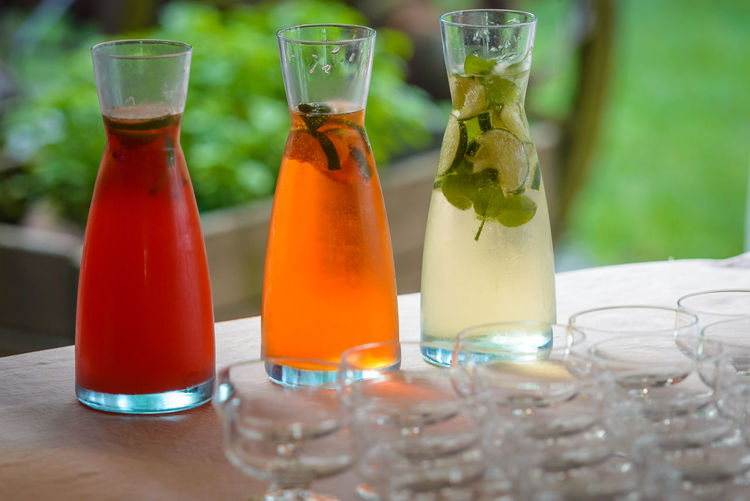 Close-Up Of Colorful Drinks In Bottles On Table