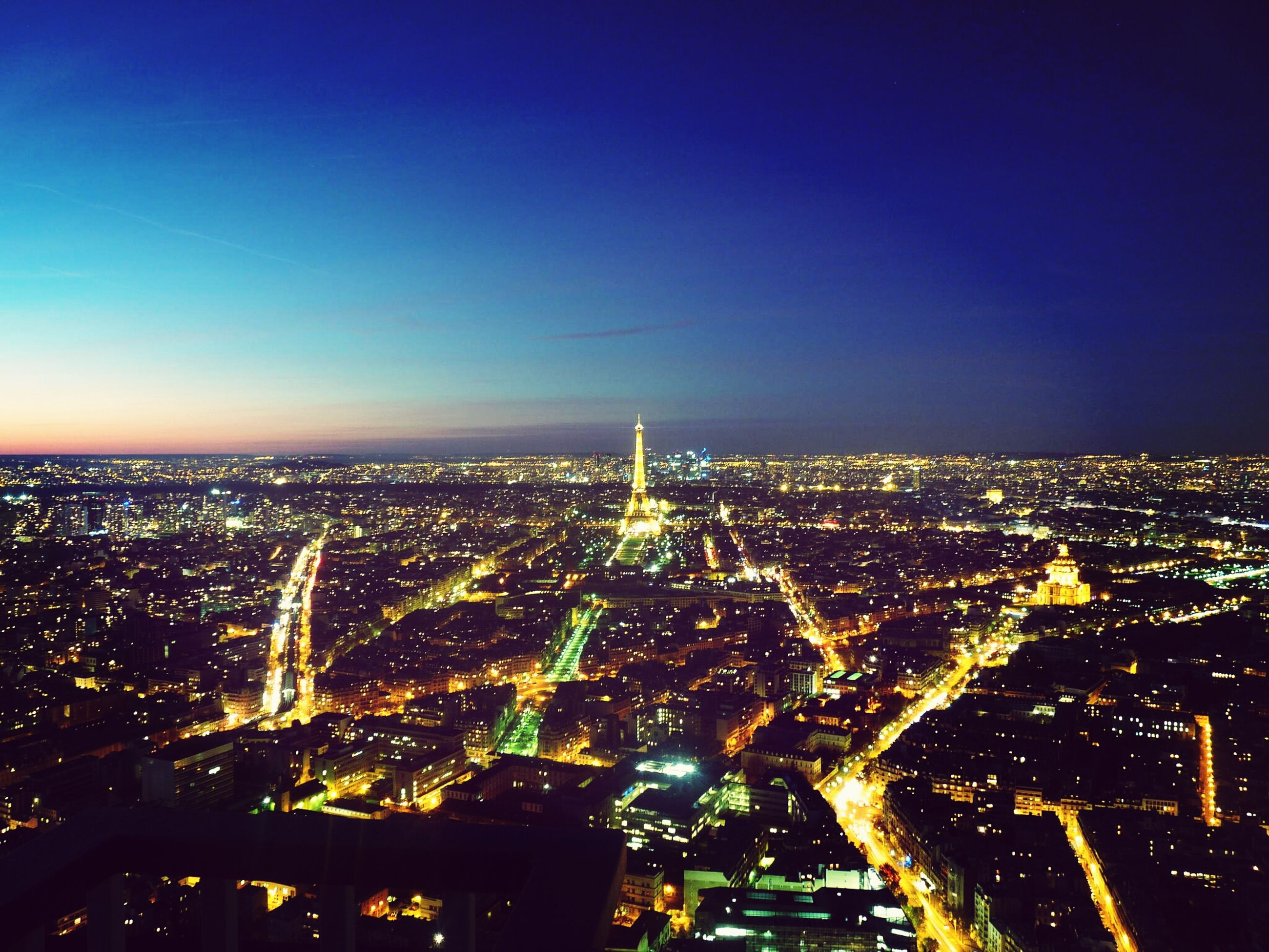 illuminated, cityscape, city, night, architecture, building exterior, built structure, high angle view, crowded, aerial view, city life, copy space, clear sky, skyscraper, sky, residential district, modern, capital cities, blue, tower