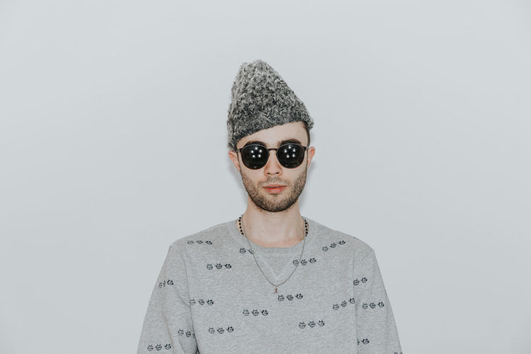 The hat. Portrait Sunglasses Hat Traditional Clothing Traditional Hat One Person Man One Man Only Young Men Studio Shot White Background Gray Background Headshot Looking At Camera Human Face Front View Men Close-up Posing Wearing Caucasian