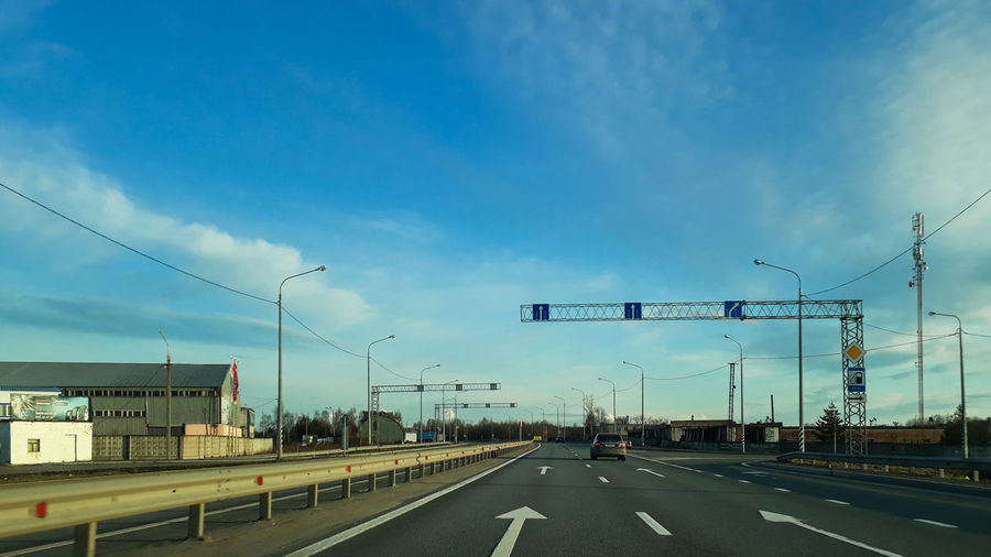 Road sign against blue sky