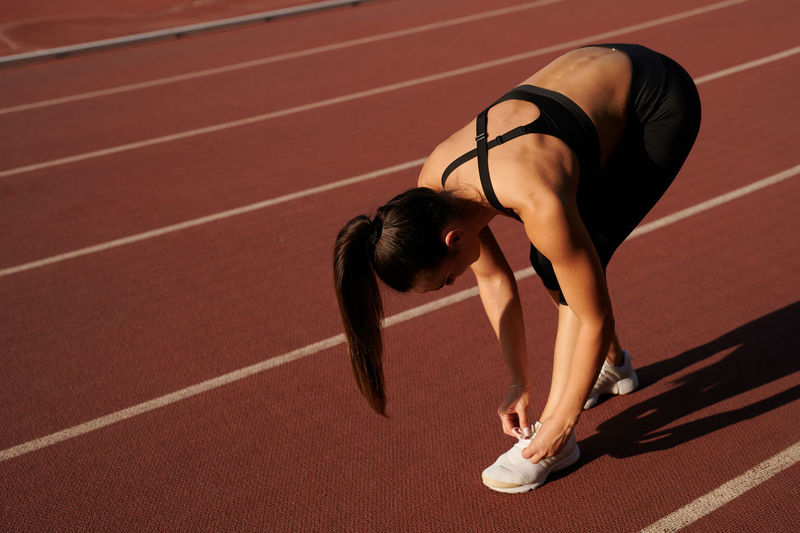 Midsection of woman running