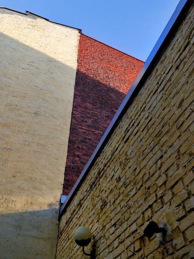 Backyards angles Backyard Angles IPhoneography Building Exterior Low Angle View Built Structure Architecture Wall Day Building Brick Brick Wall Sky Wall - Building Feature Clear Sky Window Residential District House Outdoors No People Sunlight 17.62°
