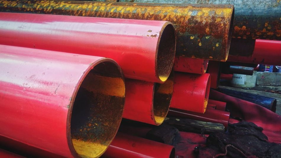 Red steel tube stacked Texture Pattern Iron - Metal Stacked Steel Red Steel Iron - Metal Red Close-up Metal Industry Steel Mill