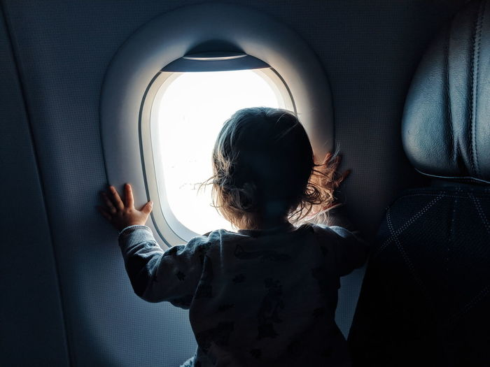Baby looking out airplane window Baby Exploration Exploring Discovery Growing Growth Child Silhouette Window Girl Baby Girl Infant Toddler  Travel Travel With Kids Childhood Aircraft Airplane Flight Commercial Airplane Airplane Seat Airplane Wing Flying