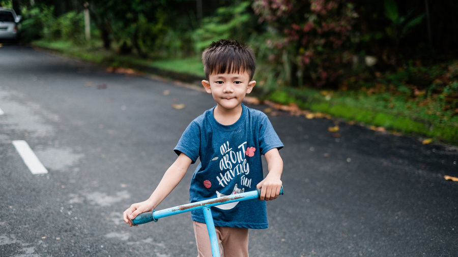 Boy standing on road