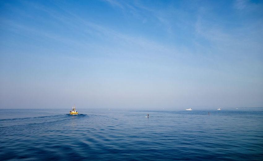 Boats sailing on sea