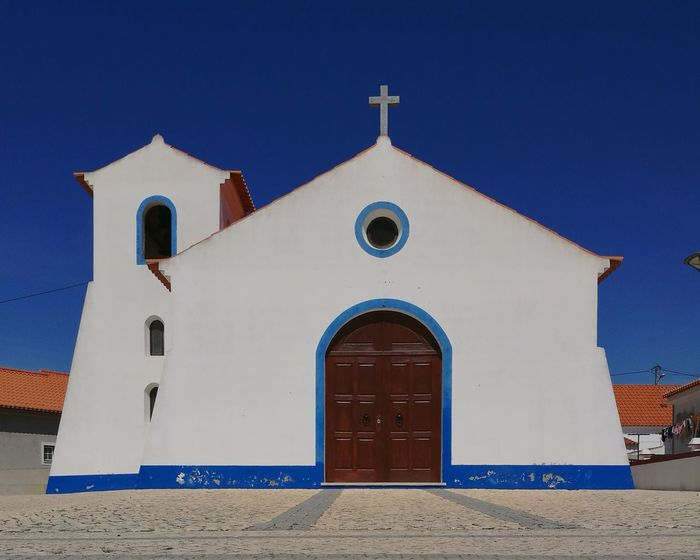 Place Of Worship Cross Blue Religion Façade Door Sky Architecture Building Exterior Built Structure Whitewashed Orthodox Church Entrance Closed Door Doorway Closed Front Door Historic