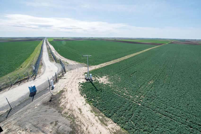 Hungarian Border Hungary Agriculture Barrier Beauty In Nature Border Border Barrier Border Fence Cloud - Sky Day Environment Farm Fence Field Green Color Hungarian Border Fence Land Landscape Military Nature No People Outdoors Plant Road Rural Scene Scenics - Nature Sky Tranquil Scene Tranquility Transportation