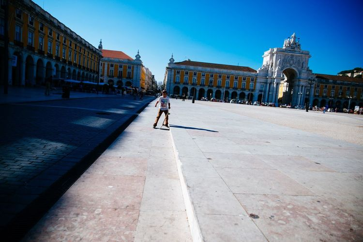 Man walking in front of historical building