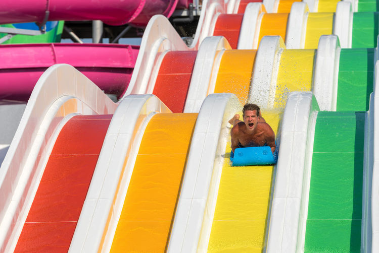 Low Angle View Of Man On Water Slide