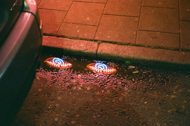 High angle view of illuminated wet street