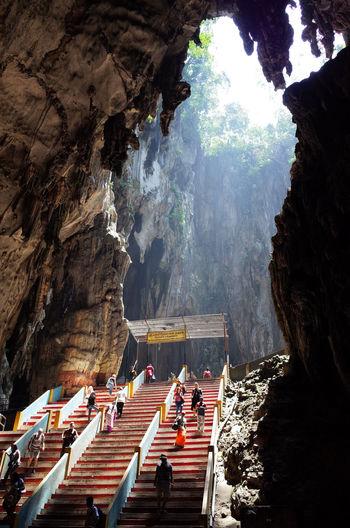 People walking on steps at batu caves