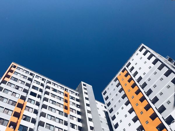Sky Low Angle View Building Exterior Built Structure Architecture Blue Clear Sky Tall - High Pattern Residential District No People Copy Space Nature Day Building Sunlight Window City Outdoors Text