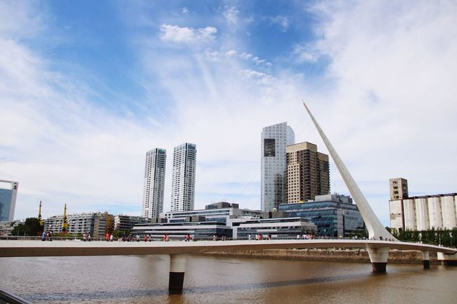 Architecture Skyscraper Built Structure Modern City Tall - High Building Exterior Sky Tower Day Water Cityscape No People Cloud - Sky Outdoors Travel Destinations Urban Skyline Puerto Madero, Buenos Aires Puente De La Mujer Argentina Bridge Modern City Calatrava Architecture