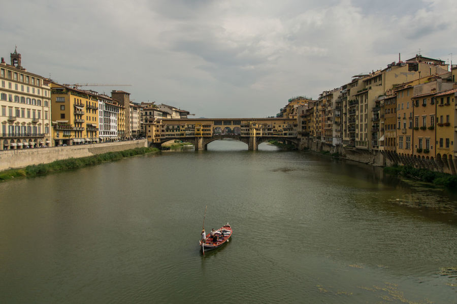 Boat in front of Ponte Vecchio Architecture Bridge - Man Made Structure Building Exterior Built Structure City Cityscape Cloud - Sky Connection Day Firenze Florence Government History No People Outdoors Ponte Vecchio Ponte Vecchio - Firenze River Sky Toskana Transportation Travel Travel Destinations Tuscany Water
