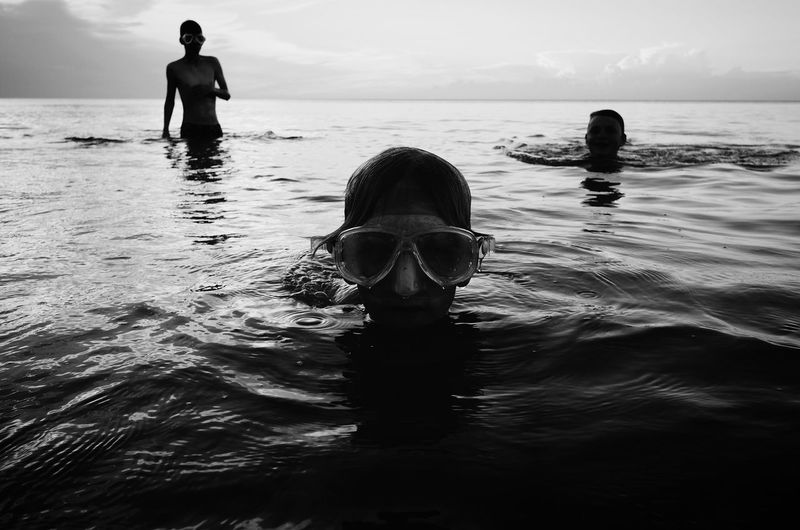 Rear view of shirtless man in swimming pool