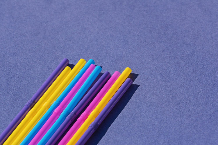 Colored disposable plastic straws on purple background with copy space. Concept of ban on use of plastic tubes in Europe in April 2020 Plastic Straws Straw Plastic Banned Stop Stirrer Ocean Pollution England 2020 Plastic Pollution Protect Environment Abstract Concept Copy Space Nobody Polyethylene Polythene Recycle Reduce Reuse Rubbish Template Top View Unhealthy Waste Zero Waste Colorful Drinking Disposable Orange Pink Reusable Drink Trash Ban Sea Water Beach Turtle Marine No Cocktail