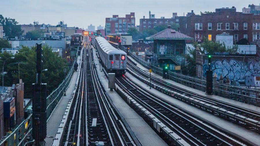 Railway Tracks In City Against Sky