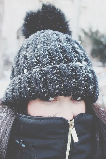 Close-Up Portrait Of Woman During Snowfall