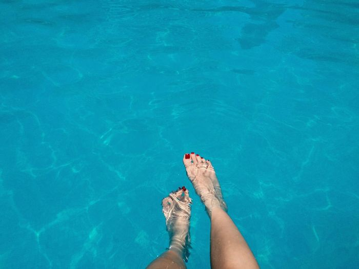 Barefoot Blue Day Elevated View Human Foot Leisure Activity Lifestyles Low Section Nature Outdoors Part Of Person Personal Perspective Relaxation Rippled Sea Swimming Pool Turquoise Colored Unrecognizable Person Vacation Vacations Water