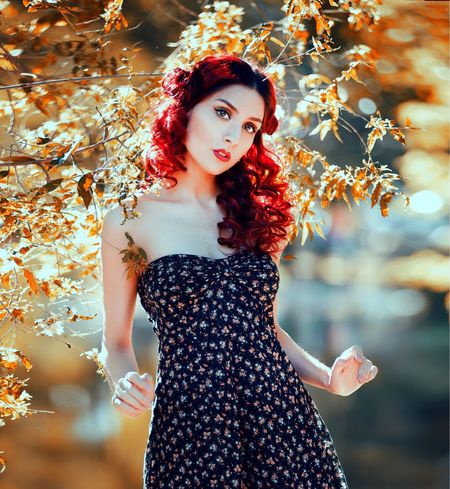 Red hair Curly Red One Person Looking At Camera Beautiful Woman Beauty Young Adult Fashion Portrait Women Adult Young Women Three Quarter Length Lipstick Lifestyles Red Front View Hairstyle Outdoors Make-up Real People