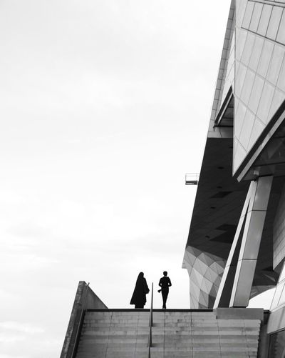 """"""" Adult Architecture Building Building Exterior Built Structure City Copy Space Day Lifestyles Low Angle View Men Modern Nature Office Building Exterior Outdoors People Real People Sky Standing Two People Walking Women The Architect - 2018 EyeEm Awards The Street Photographer - 2018 EyeEm Awards"""
