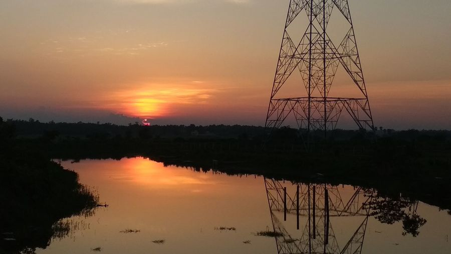 sun is getting real low Sunrise Steel Structure  Water Sunset Steel Silhouette Lake Reflection Symmetry Business Finance And Industry Sky Romantic Sky Calm Reflection Lake Sky Only Reflecting Pool Standing Water EyeEmNewHere
