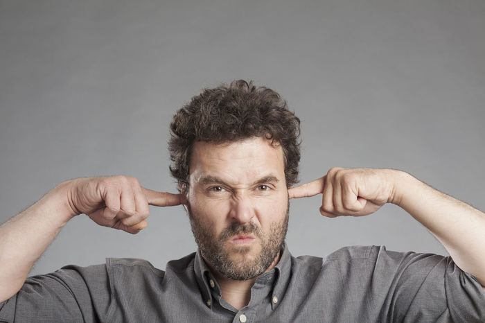 Man Negative Not Senses Close-up Ears Finger Front View Gesturing Hearing Impairment Listen Looking At Camera Male Mood One Person People Portrait Real People Studio Shot