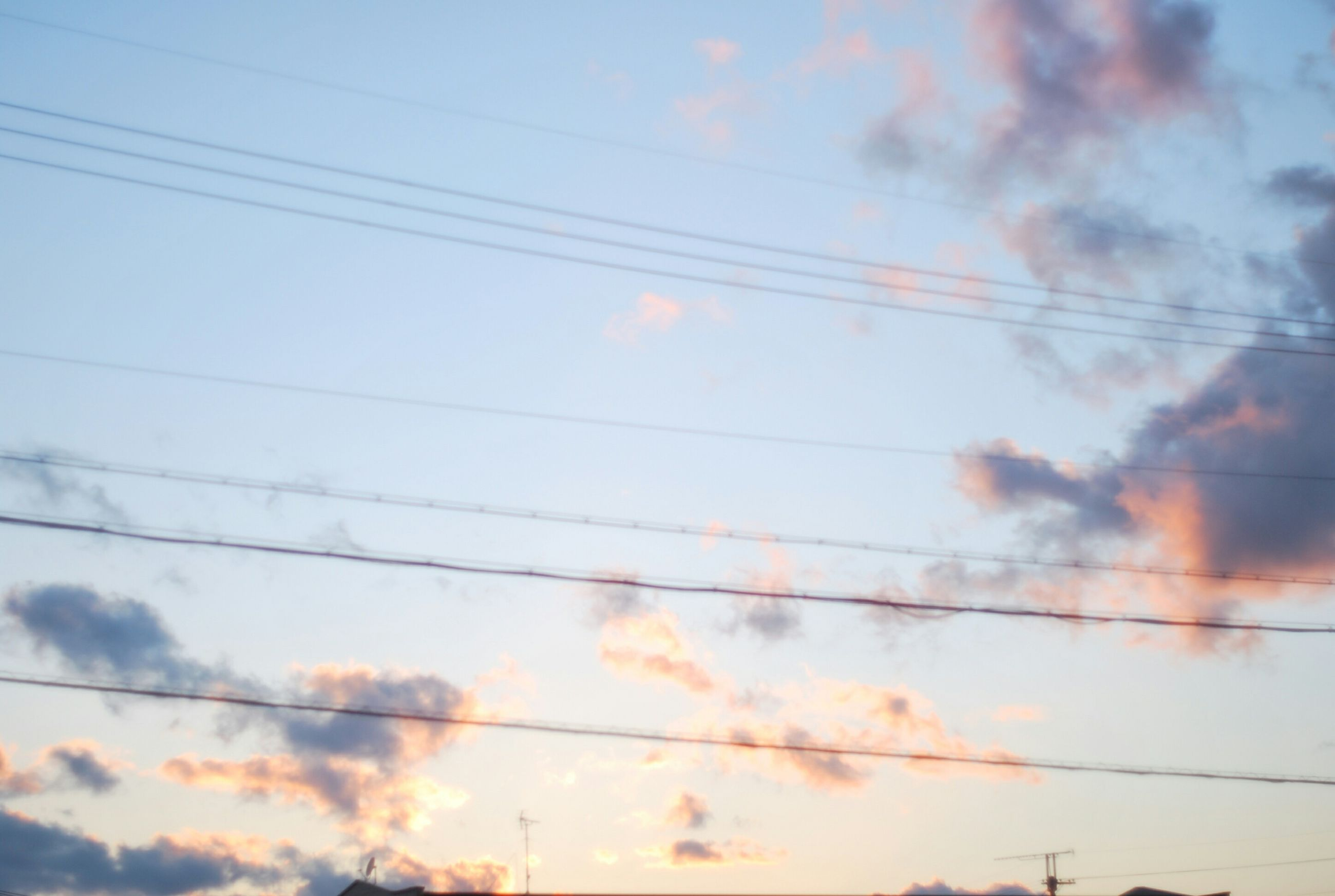 power line, sky, cable, cloud - sky, electricity pylon, power supply, electricity, low angle view, cloudy, connection, sunset, tranquility, cloud, scenics, beauty in nature, tranquil scene, power cable, nature, fuel and power generation, silhouette