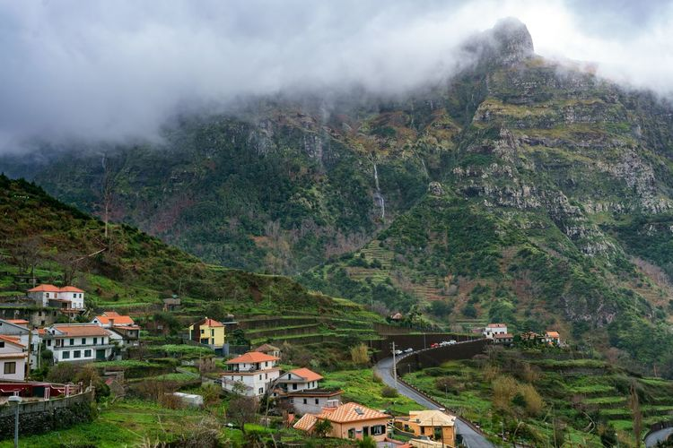 Village and beautiful mountains with clouds, in Madeira Autumn Cloudy Epic Madeira Nature Panorama Panoramic Portugal Portuguese Road Scenic Travel Winter Aerial Aerial View Architecture Best  Buildings Europe Ilha Island Landscape Moody Mountain Outdoors
