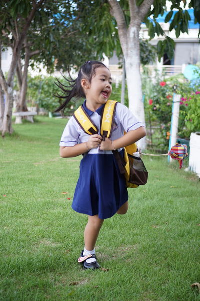 Khwan Khaw after school. Student Thai Thailand After School Casual Clothing Child Childhood Day Females Field Front View Full Length Girl Girls Grass Innocence Kid Land Leisure Activity Nature One Person Outdoors Plant Real People Student Uniform Tree Unifrom Women Young Adult The Portraitist - 2018 EyeEm Awards The Fashion Photographer - 2018 EyeEm Awards The Still Life Photographer - 2018 EyeEm Awards