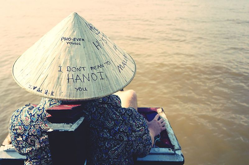 I Am Pho Ever Young Quotes Rear View One Person Outdoors Leisure Activity River River Boat Boat Hat Traditional Clothing Travel Destinations Mekong Delta Vietnam Relaxing
