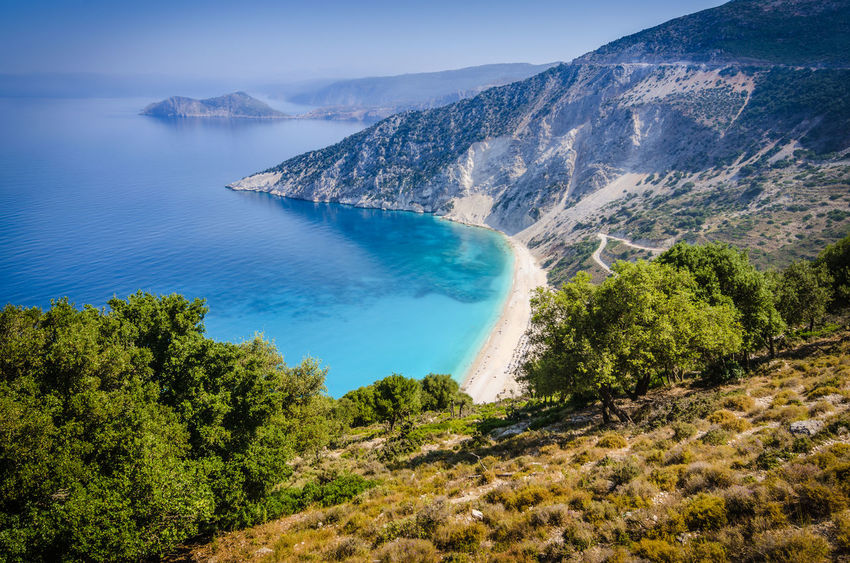 Aerial View of beautiful Myrtos Bay and Beach on Kefalonia Island, Summer Day, Greece Kieselsteine Panorama Beach Beauty In Nature Blue Cefalonia Cephalonia Coast Famous Place Greece Hill Ionian Kefalonia Lagoon Mountain Myrtos Beach Outdoors Overlook Rock - Object Scenics Sea Tourism Travel Destinations Turquiose Water