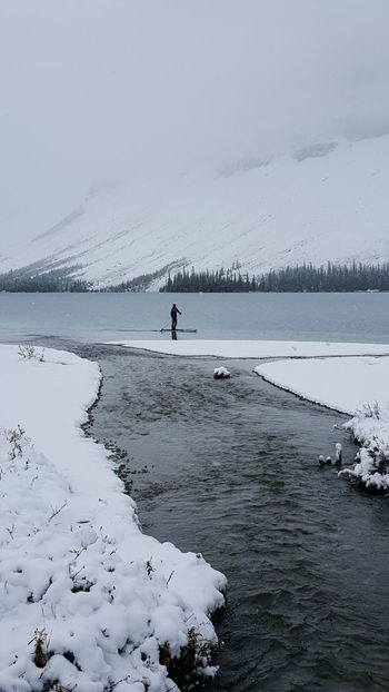 Tranquil Scene Water Scenics Cold Temperature Tranquility Vacations Snow Nature Beauty In Nature Sea Calm Solitude Non-urban Scene Outdoors Ocean Day Remote Winter Wonderland Snow Covered Canadian Rockies  Recreation  Season  Water Sports Lake Paddle Boarding