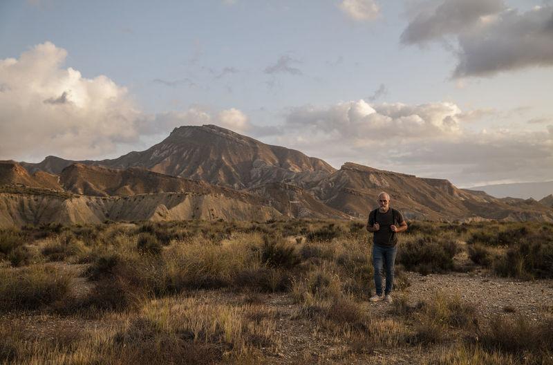 Full length of man standing on land against sky