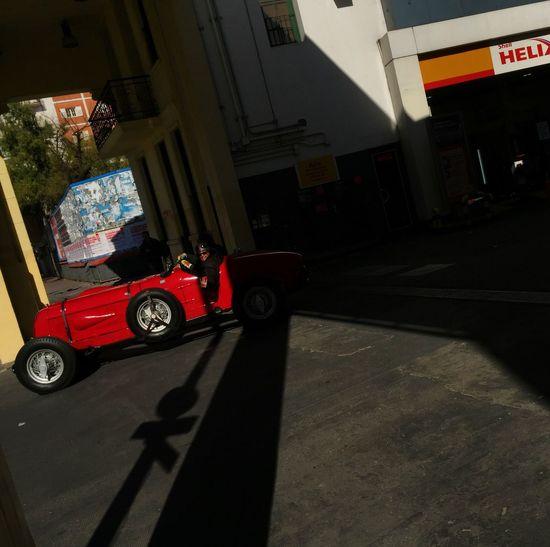 Transportation Mode Of Transportation Land Vehicle City Car Motor Vehicle Shadow Street Day Road Outdoors