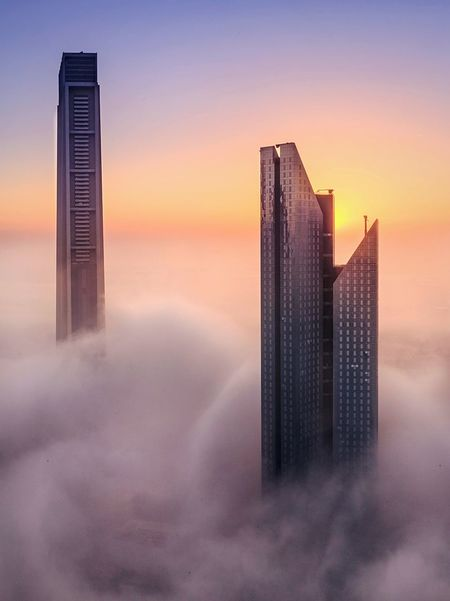 Foggy Dubai Foggy Morning Sunrise From Above  Above The Clouds Advertisement Tourist Attraction  Tourist Destination Dubai Tourism Dubai Skyline Backgrounds Skyporn Dubai Fog Sky Architecture Skyscraper Built Structure Office Building Exterior Building Exterior City Building Landscape Nature Urban Skyline Cityscape Tower Dramatic Sky Modern Scenics - Nature Outdoors