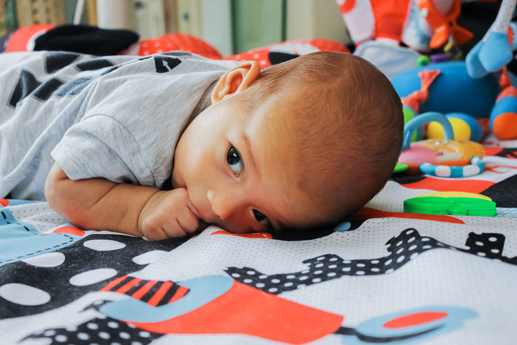 Portrait of cute baby girl with toy