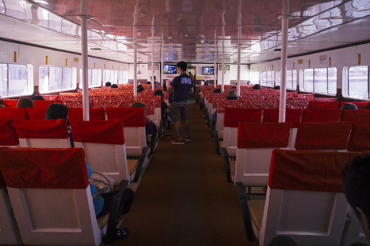 View of red chairs in corridor