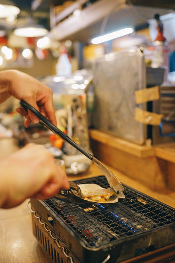 Japanese Seafood Human Hand Hand One Person Real People Human Body Part Holding Indoors  Focus On Foreground Occupation Unrecognizable Person Food And Drink Working Food Preparation  Men Lifestyles Business Chopsticks Freshness Finger