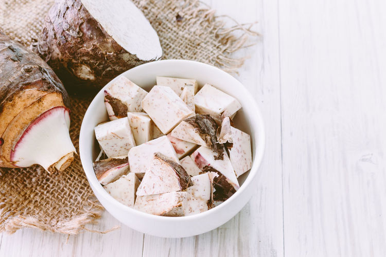 Taro root on wooden background Bowl Bread Choice Close-up Dairy Product Directly Above Food Food And Drink Freshness Healthy Eating High Angle View Indoors  Meat No People Ready-to-eat Still Life Table Taro Root Temptation Variation Wellbeing Wood - Material