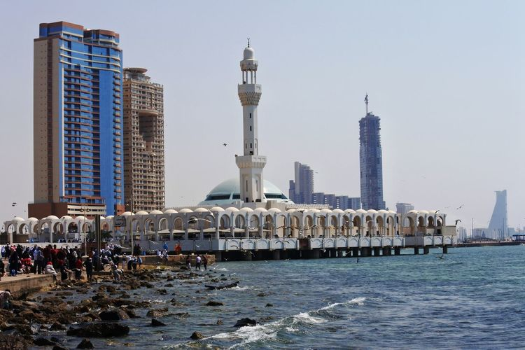 Masjid Ar-Rahmah (Floating Mosque), Red Sea. Architecture Beach Building Exterior Built Structure City Clear Sky Day Large Group Of People Nature Outdoors People Real People Sea Sky Skyscraper Tourism Travel Destinations Vacations Water Waterfront