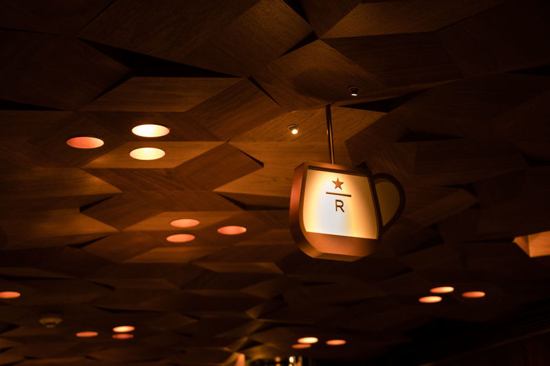 Illuminated Indoors  Low Angle View Lighting Equipment Ceiling No People Human Representation Communication Hanging Sign Light Electric Light Representation Electricity  Wood - Material Information Architecture Domestic Room Pattern Recessed Light Light Fixture Starbucks Reserve Roastery Shanghai Starbucks Coffee