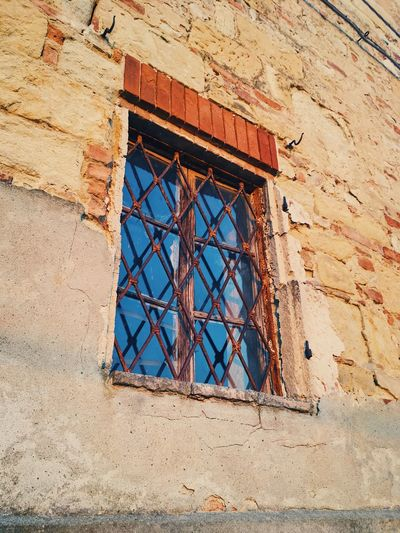 Close-up of window, old town in Italy. Architecture Architecture Building Exterior Built Structure Day Italian Architecture Italy Low Angle View No People Old Windows Outdoors Reflections Steelwork Stonework Window